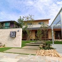 芝と石の美しいナチュラルなオープンエクステリア